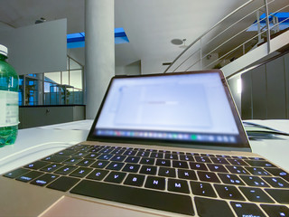 Modern laptop inside modern office. Corporate concept