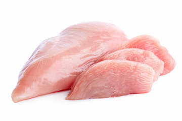 Three slices of uncooked boned chicken breast next to whole chicken breast isolated on white.