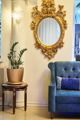 Old carved round mirror with gilding