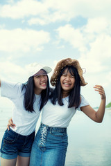 two cheerful asian teenager happiness emotion on sea beach