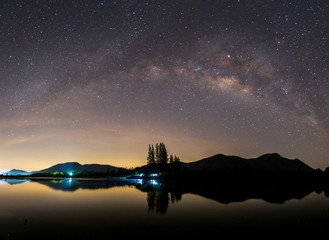 The Milky Way rises over the mountain, on a foreground