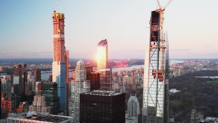 Fototapete - Buildings of Midtown Manhattan with Central Park at sunset