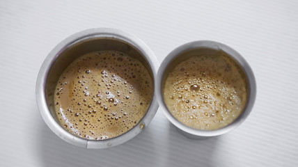 Indian filter coffee is famous coffee in steel cup.