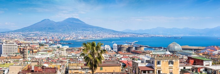Photo sur Aluminium Naples Panoramic view of Naples, Italy. Castel Nuovo and Galleria Umberto I towering over roofs of neighboring houses of Naples.