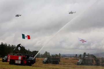 A firetruck gives a water cannon salute during an official event to mark the beginning of the construction of a new international airport, at the Santa Lucia military airbase in Zumpango