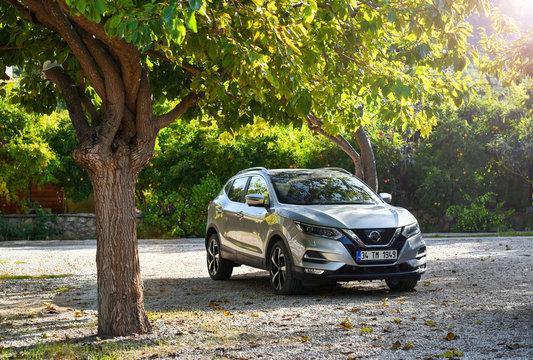 Marmaris / Turkey - 10.04.19: Crossover car Nissan Qashqai 2019 in tangerine garden