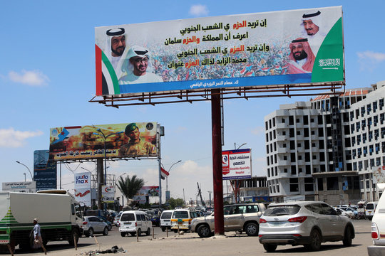 Poster of Saudi and Emirati leaders are seen on a billboard on a street in the southern port city of Aden, Yemen