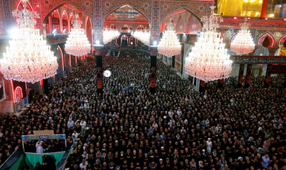Shi'ite Muslim pilgrims attend prayers, ahead of the holy Shi'ite ritual of Arbaeen at the Imam Hussein shrine in the holy city of Kerbala