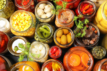Spoed Foto op Canvas Keuken Open jars with pickled vegetables and dill inflorescences on grey table, flat lay