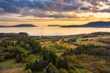 Sunset Aerial View of Rural Lummi Island, Washington. Located in the Puget Sound area of Washington state this rural island offers a peaceful retreat and boasts the famous award winning Willows Inn.