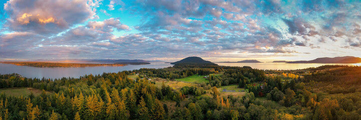 Aluminium Prints Panorama Photos Sunset Aerial View of Rural Lummi Island, Washington. Located in the Puget Sound area of Washington state this rural island offers a peaceful retreat and boasts the famous award winning Willows Inn.