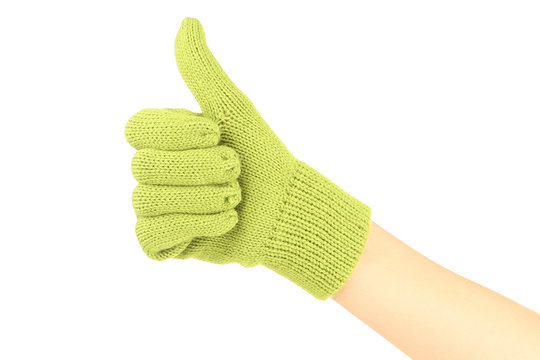 Hand in knitted mitten showing thumb up on white background