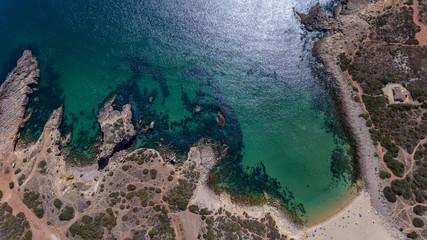 Aerial. View from the sky of the beach of Ingrina Villa to Bishpo. Portugal Algarve.