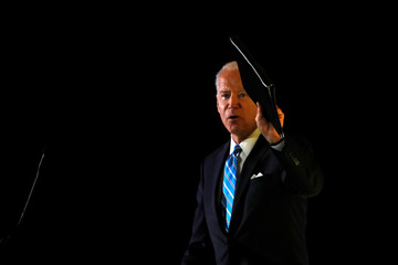 Democratic presidential candidate former Vice President Joe Biden waves after he delivered a speech during the Women's Leadership Forum in Washington