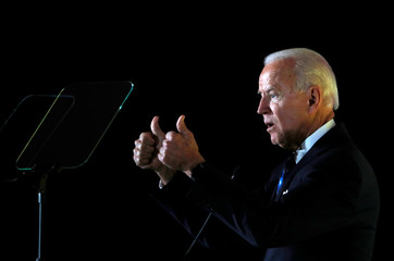 Democratic presidential candidate former Vice President Joe Biden reacts as he delivers a speech during the Women's Leadership Forum in Washington