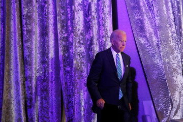 Democratic presidential candidate former Vice President Joe Biden arrives to deliver a speech during the Women's Leadership Forum in Washington