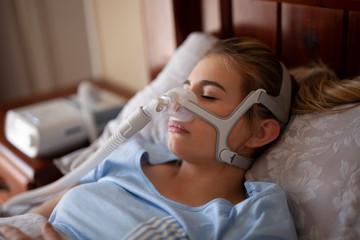 Cpap machine, Woman using sleeping sleep apnea