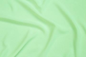 Abstract waving green fabric texture background, blank waving green fabric pattern background Wall mural