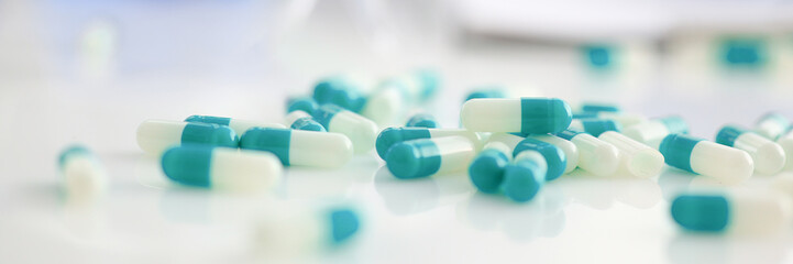 Tablets scattered on the table of the pharmaceutical