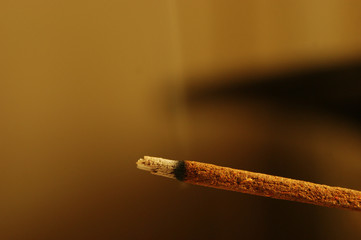 Incense stick burning with smoke, close up, macro.