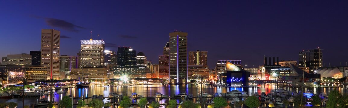 Colorful Baltimore skyline over the Inner Harbor at dusk