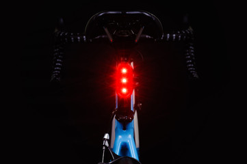 Close-up of illuminated bicycle tail light