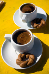 A cups of traditional greek coffee with cookie  served in all over the Greece
