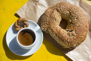 Greek breakfast, a cup of greek coffee whit sesame bread ring Koulouri. Taken in Naxos