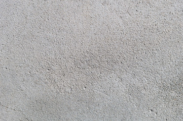 Gray textured cement wall background with fine concrete chips. Construction backgrounds