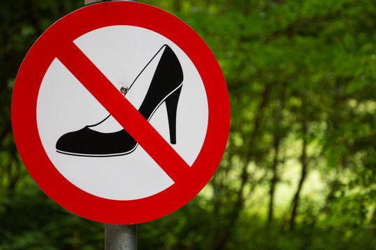 A sign that forbids the ladies' entrance with shoes on their feet...