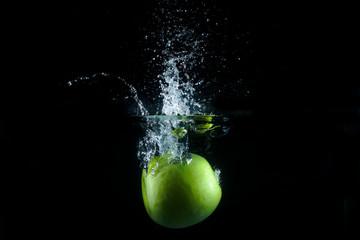 Printed roller blinds Splashing water Water splash and fruits isolated on black backgroud. Fresh Apple.