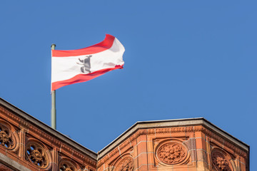 A detail of the Red Town Hall (Rotes Rathaus) of Berlin on which the Berlin flag is flying, Germany