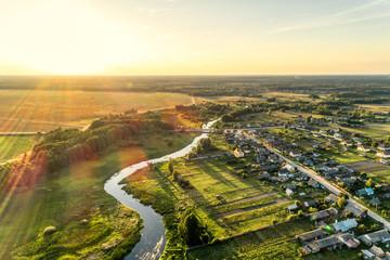 Aerial view. Small european village. Blue winding river. Wall mural