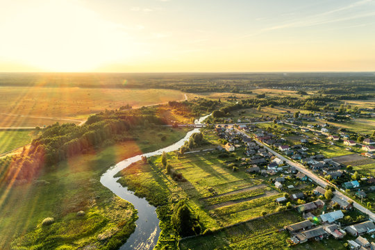 Aerial view. Small european village. Blue winding river.