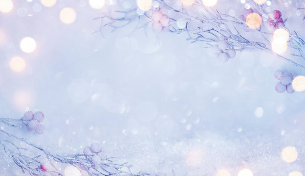Abstract winter holidays background with snowy branches and red berries
