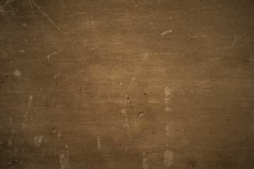 Dark brown plywood background. Texture dirty cracked painted chipboard, abstract background