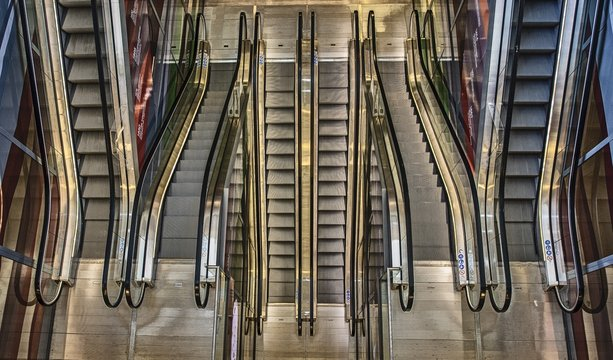 High angle shot of long escalators going up and down in a building