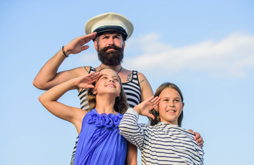 welcome on board. small girls marine fashion. parenting discipline. sea cruise. have good swim. bearded sailor with kids. father back home. family day. dad and daughters outdoor. ship captain salute