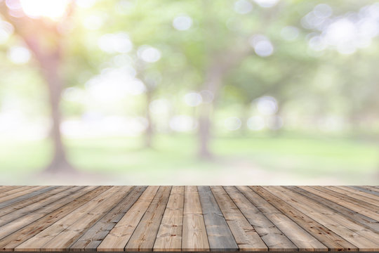 Empty wooden board space platform with natural bokeh blurred