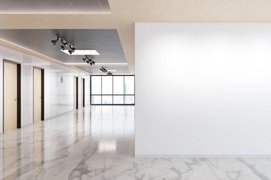 Blank wall in marble and wooden office mockup with large windows and sun passing through 3D rendering