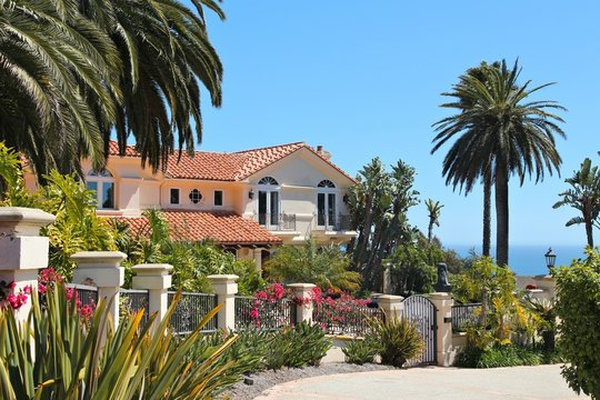 MALIBU, UNITED STATES - APRIL 6, 2014: Luxury California residential home as seen from public road in Malibu, USA. Real estate rates in California have grown 105 percent since 1990.