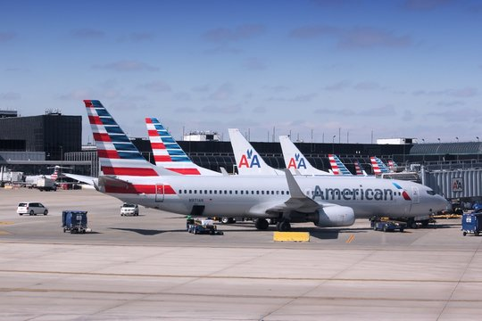 CHICAGO, UNITED STATES - APRIL 1, 2014: American Airlines fleet at O'Hare Airport in Chicago. With 106 million pax in 2011, AA is the 5th largest airline worldwide.