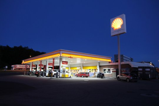 SANDEFJORD, NORWAY - AUGUST 2, 2015: People fill their cars at Shell gas station in Sandefjord, Norway. Royal Dutch Shell is the 6th largest company in the world by 2016 revenues.
