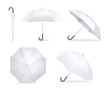 Realistic white umbrella open and folded lying in different angles