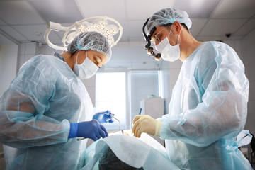 The surgeon, the dentist and the nurse, perform an operation on the patient. The concept of...
