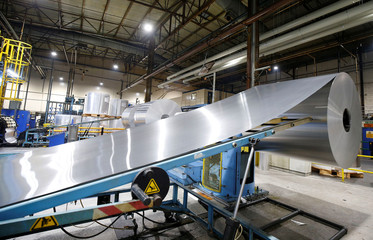 A roll of aluminium is seen at the start of the can making process on the production line at Ball Corporation, Wakefield