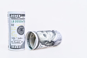 Rolls 100 US dollar banknotes on white background.copy space
