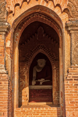 Buddha statue protected from the sun by his Bagan Myanmar Pagoda