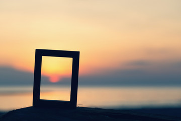 Picture frames placed on sandy beaches during the time Sunset concept idea background nature style abstract Wall mural