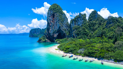 Poster Beach Aerial view Phra Nang Cave Beach with traditional long tail boat on Ao Phra Nang Beach, Railay Bay, Krabi, Thailand.